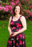 Middle age woman with a glass of wine Stock Photo
