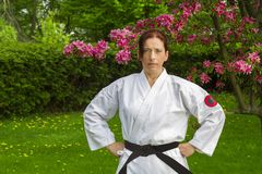 Strong woman in gi Royalty Free Stock Photography