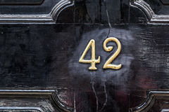 Forty Two. Number forty two on black door Stock Image