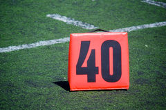 Forty Yard Line. Orange yard marker designates the forty yard line on a football field royalty free stock images