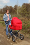 Forty-year mother and baby carriage Royalty Free Stock Photography