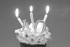 Forty years celebration. A forty year celebration, with candles and cupcake treats stock photo