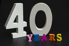 Forty years. Figures and year on a black background Royalty Free Stock Image