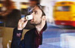 Businessman drinking espresso coffee in the city cafe Royalty Free Stock Images