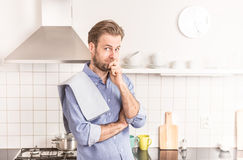 Forty years old caucasian man or chef in the kitchen Royalty Free Stock Photos