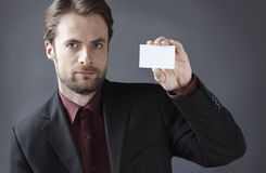 Serious businessman presenting blank business card Royalty Free Stock Photography