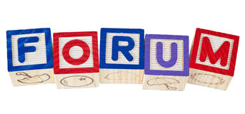 Forum. Wooden blocks forming the word forum isolated on white background Royalty Free Stock Photography