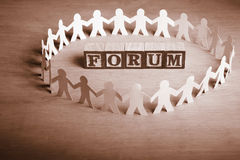 Forum. Word 'Forum' surrounded by people paper dolls Royalty Free Stock Photos