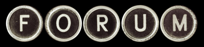 Forum. Spelled out in old typewriter keys.  Lots of dust, rust and scratches, on black background Royalty Free Stock Image