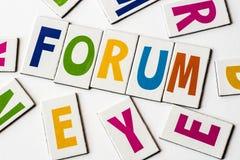 Forum di parola fatto delle lettere variopinte Fotografie Stock