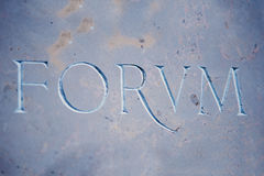 FORUM inscription on blue marble Royalty Free Stock Photos