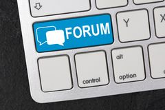 Forum. Keyboard in Detail with graphic shows a logo with two speech bubbles and the word Forum stock images