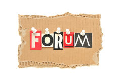 Forum. Lettering FORUM with newspaper letters on a cardboard Royalty Free Stock Photo