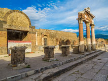 The forum in Pompeii, Italy. Ancient columns and ruins in the forum in the archaeological site of  Pompeii, Campania, Italy Royalty Free Stock Photos