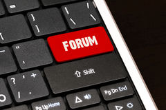 Forum on Red Enter Button on black keyboard Stock Photos