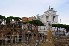 Forum Romanum. With its  ruins of several important ancient government buildings at the center of the city of Rome and Monumento Vittorio Emanuele  It is Stock Images