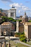 Roman Forum. Forum Romanum: Overview from palatine Hill facing North portrait mode showing the arch of Septimius Severus, Church of San Giuseppe dei Falegnami royalty free stock photo