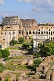 Roman Forum. Forum Romanum: Overview from palatine Hill facing South: Colosseum and Titus` arch portrait mode Royalty Free Stock Image