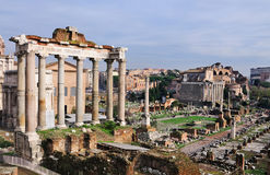 Forum Romanum: Temple of Saturn. The Temple of Saturn on the Forum Romanum in Rome, Italy. The picture also shows the Curia, the temple of Antoninus and Faustina Stock Image