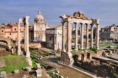 Forum Romanum: Temple of Saturn. The Temple of Saturn on the Forum Romanum in Rome, Italy. The picture also shows the Curia, the temple of Antoninus and Faustina Stock Photos