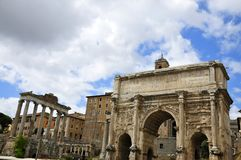Roman Forum. Forum Romanum: Triumphal Arch of Septimius Severus, next to the spot of the Umbilicus Urbi: the symbolic centre of the city from which and to which Stock Photos