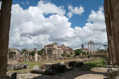 The Forum, Rome, Italy. With a dramatic backdrop of clouds looking through the columns Stock Photography