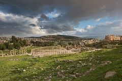 The forum vista of the ancient city of Gerasa after a storm. With dark grey clouds Royalty Free Stock Image