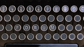 Forum, Word on vintage type writer letter keys. From 1920s close up, digital composing Royalty Free Stock Photos