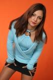 Forward. Beautiful girl and orange Background stock image