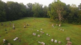 Forward Aerial Above Historic Cemetery. 9145 A forward high angle aerial above a historic cemetery in the woods stock footage