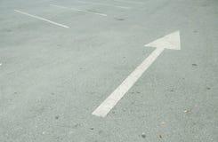 Forward arrow sign on the parking area. Forward white arrow sign on the parking area Stock Images