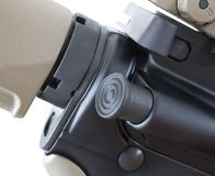 Forward assist. Button on an AR style rifle to close the bolt Stock Photo