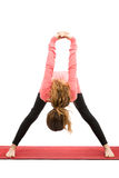 Forward bend with shoulder stretching in yoga Stock Photo
