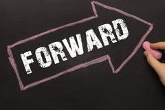 Forward - Chalkboard with arrow on black Stock Image