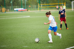 Forward of CSP Izmailovo dribbles ball in game against team Mordovochka Royalty Free Stock Images