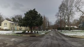 Forward Driving Perspective on Wintry Upscale Neighborhood Street. 10130 A forward driving perspective on the streets of an upscale residential neighborhood on a stock footage
