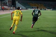 Forward fc krasnodar Vandersson andersson escapes from midfielder Sergei Tkachev Royalty Free Stock Photos