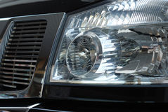 Forward headlight of the black car Royalty Free Stock Images