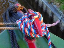 Forward mooring post on canal narrowboat. The forward mooring post and mooring ropes on a canal narrowboat in England Stock Photography