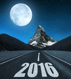 Forward to the New Year 2016. Asphalted road in mountain landscape .Forward to the New Year 2016 Stock Photo