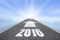 Forward to 2016 new year concept. Asphalt road with arrow Royalty Free Stock Images