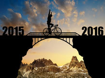 Forward to the New Year 2016. Cyclist riding across the bridge. Forward to the New Year 2016 Stock Image