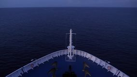 Forward View of a Large Cruise Ship`s Bow Traveling on the Open Ocean. 8766 An evening establishing shot of a large cruise ship`s bow as it travels on the open stock footage