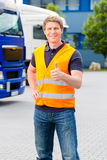 Forwarder in front of trucks on a depot. Logistics - proud driver or forwarder in front of trucks and trailers, on a transshipment point stock photos