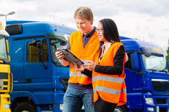 Free Forwarder In Front Of Trucks On A Depot Royalty Free Stock Photo - 38249595