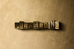 FORWARDING - close-up of grungy vintage typeset word on metal backdrop Royalty Free Stock Images
