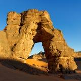Forzhaga Arch - Natural Rock Arch - Akakus, Libya. Sunset at Forzhaga Arch - Huge natural rock arch - Akakus (Acacus) Mountains, Sahara, Libya royalty free stock photography