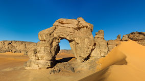 Forzhaga Arch - Natural Rock Arch - Akakus, Libya. Forzhaga Arch - Huge natural rock arch - Akakus (Acacus) Mountains, Sahara, Libya stock photography