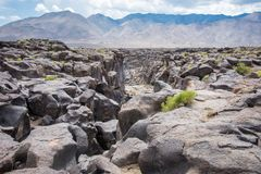 Fossil Falls formed years ago when the Owens River carved through the volcanic basalt rocks in the Eastern Sierra Nevada of. California royalty free stock photos