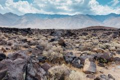 Fossil Falls formed years ago when the Owens River carved through the volcanic basalt rocks in the Eastern Sierra Nevada of. California royalty free stock images